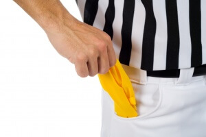 Referee holding penalty flag